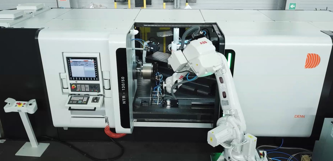 DENN NTR metal spinning machine with robot